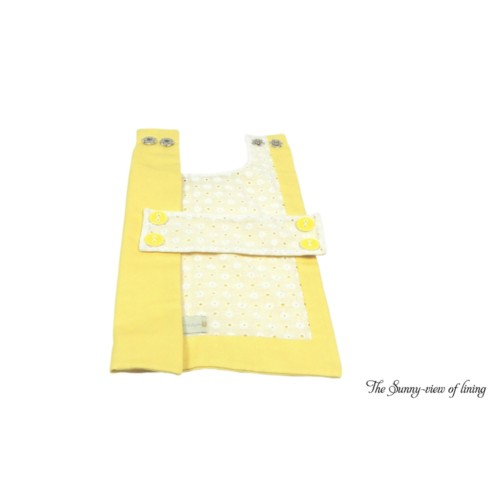 A bright yellow organic cotton dog coat with white eyelet lace accents by Couture by Sophie-the lining