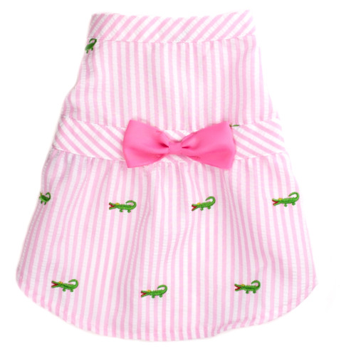 the latest spring fashion trends for your dog. Pink/white stripe seersucker with alligators dress, front view.